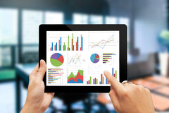Analyzing graph with tablet Royalty Free Stock Photography