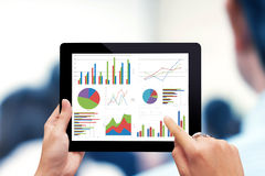 Analyzing graph with tablet Stock Image