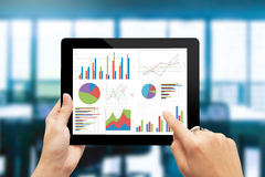 Analyzing graph with tablet Stock Photos