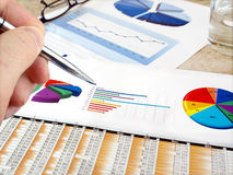 Analyzing investment charts. Royalty Free Stock Images