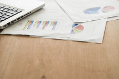 Analyzing investment charts with laptop. Accounting Royalty Free Stock Photos