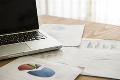 Analyzing investment charts with laptop. Accounting Royalty Free Stock Image