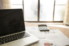 Analyzing investment charts with laptop. Accounting Royalty Free Stock Photography