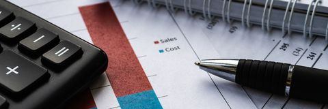 Analyzing investment charts and statement and financial report stock photos
