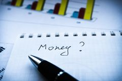 Analyzing investment statement and fianancial report, business plan royalty free stock images