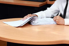 Analyzing paper work Stock Image