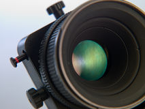 Analyzing processes camera. Professional camera lens close-up on a white background Stock Image