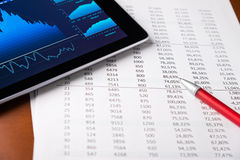 Analyzing report with tablet-pc Royalty Free Stock Photos