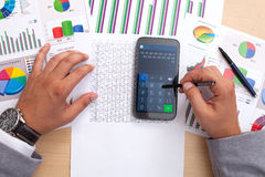 Analyzing statistics with smart phone calculator Stock Photo