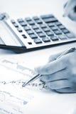 Analyzing stock charts Stock Photo