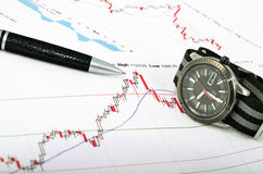 Analyzing the stock market. Time is money. Concept Royalty Free Stock Images