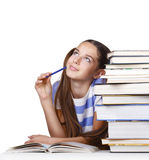 Analyzing student girl. Beautiful girl student ponders lying beside books. Isolated on a white background Stock Image
