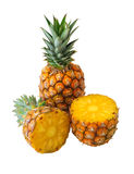 Ananas. Isolated whole and half pineapples on white background Stock Photo