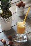 Ananas e succo del litchi Fotografia Stock Libera da Diritti