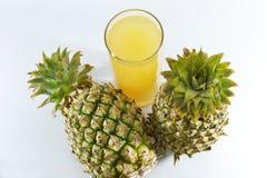 Ananas et jus Images libres de droits