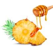 Ananas et miel Photographie stock