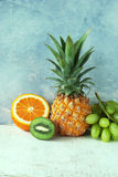 Ananas. Healthy fruit background, Ananas and different fresh fruits on wooden table Royalty Free Stock Photos