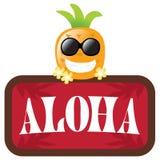 Ananas isolato con il segno di colore rosso Aloha Immagine Stock