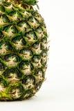 Ananas lokalisiert auf weißem Hintergrund Der rote Samen ist der Inhalt Lizenzfreies Stockfoto