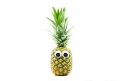 Ananas med googly ögon på vit bakgrund Royaltyfri Foto