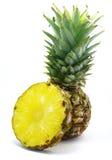 Ananas met zijn plak Stock Foto