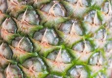Ananas sulla superficie di legno del fondo Fotografia Stock