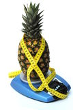 Ananas with tape rule. On kitchen scales. concept of diet Royalty Free Stock Photography
