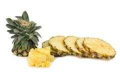 ananasowy plasterek ciący odizolowywającym na białym tle Fotografia Royalty Free