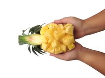 Ananassnitt som är halvt på vit bakgrund royaltyfria foton