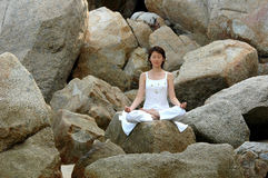 Ananda Yoga on the rock Stock Photo