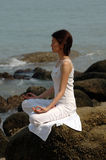 Ananda Yoga on the rock Stock Image