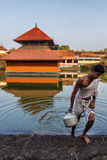 Ananthapura Lake Temple. A devotee fetching water from the a Lake,where the famous Ananthapura Lake Temple is situated at in Kasaragod-a district in Malabar Stock Images
