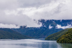 Ananuri lake. The Ananuri lake with clouds Royalty Free Stock Image