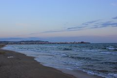 Anapa at the end of a hot southern day. The city of Anapa in the rays of the setting sun on the background of a troubled sea Stock Photo