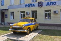 Police retro car GAZ-21 `Volga` near the building of the DPS company in the settlement of Dzhemete, Anapa Stock Image
