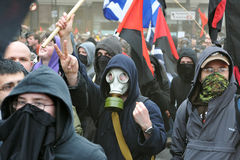 Anarchist Protesters in London. A breakaway group of anarchist protesters march through the streets of the British capital during a large anti-cuts rally on Royalty Free Stock Photography