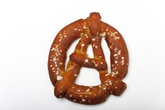 Anarchy. Bavarian prezel in the shape of the anarchy sign Stock Image