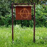 Anarchy graffiti on old metal notice board Royalty Free Stock Photos