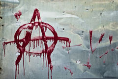 Anarchy graffiti. Anarchy symbol sprayed on the gray metal background Stock Photos