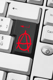 Anarchy key. Anarchy symbol on the keyboard - rioters message of rebellion on the web - online communication of revolution - internet connection between Stock Photography