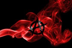 Anarchy smoke flag. Isolated on a black background Royalty Free Stock Image