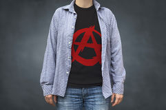 Anarchy symbol print on t-shirt, political message. Selective focus Stock Photos