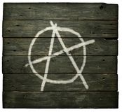 Anarchy symbol. On wooden background Royalty Free Stock Photo