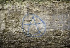 Anarchy wall symbol. Anarchy symbol painted on wall, textures and backgrounds Royalty Free Stock Photos