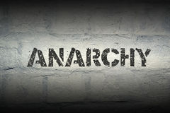 Anarchy WORD GR. Anarchy stencil print on the grunge white brick wall Royalty Free Stock Photo