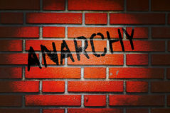 Anarchy Written on Brick Wall. Of a building illuminated with spotlight Stock Images