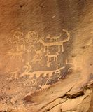 Anasazi Petroglyphs. Ancient Anasazi petroglyphs etched into a rock wall royalty free stock images