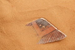 Anasazi pottery shard in red sand Stock Photo