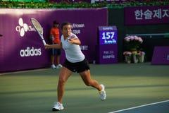 Anastasija Sevastova Running forehand royaltyfria bilder