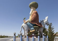 ANATOLIA, TURKEY - MAY 07, 2015: Photo of The monument to Hodja Nasreddin. Sculpture of a man sitting on a donkey, on a small pedestal at the highway. May 7 Royalty Free Stock Photos